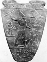 Co zobrazuje artefakt známý jako Narmerova paleta?(viz.obr.) (náhled)