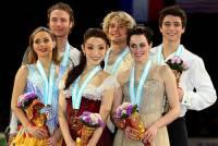 Kteří medailisté stojí na stupních vítězů na fotografii č.1? (náhled)