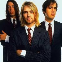 Z obrázku č.21 se dívají členové slavné hudební skupiny: (náhled)
