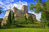 V jakém stavebním slohu je postaven hrad na fotografii č.6? (náhled)