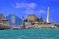 Fotografie č.7 je z přístavního města: (náhled)